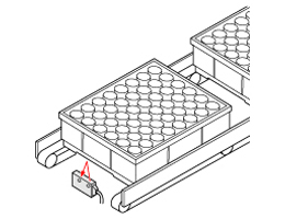 Positioning of trays